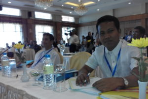 Maung John during migration forum